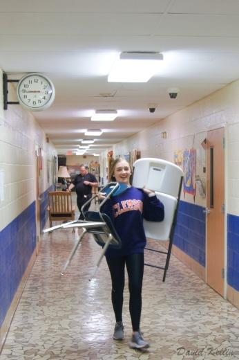 Caroline Wrenn brings more chairs