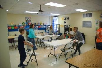Teachers and volunteers help create classrooms for the AJMS 7th grade students who will be attending starting Tuesday.