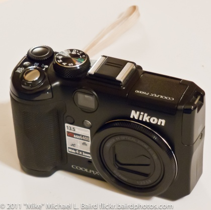"Nikon Coolpix P6000 13.5MP Digital Camera with 4x Wide Angle Optical Vibration Reduction (VR) Zoom. I paid $360 in January 2009. Includes $18 leather Nikon case for P6000. Does not include SDHC card. Works fine, no defects or problems... I'm just gathering the resources to buy an SLR with video capability. In original packaging with all manuals and cables, battery, charger, etc., almost like new... lightly used. This is one of my favorite little cameras. When a Pro Nikon shooter uses a point-and-shoot, the P6000 or P7000 is the model of choice. This is one of the few point-and-shoot cameras that shoots in RAW and has full manual controls, and the only one that also has built-in GPS for automatic geo-tagging of every image. The Nikon P6000 is the superior Nikon equivalent to the small non-SLR Canon G12, generally the Pro choice for Canon shooters, but which is also bulkier and larger. I'm normally an all Canon shooter except when it comes to this category of small-carry camera. For some an optical viewfinder is essential, and the P6000 has that, as well as a hot shoe for external flash. Announced August 2008. http://www.dpreview.com/news/0808/08080702nikonp6000.asp said ""Nikon has announced its flagship compact, the Coolpix P6000. Built around a 13.5 megapixel, 1/1.72 inch sensor (0.41 square cm), the camera has a 4x zoom starting at a respectably wide-angle - equivalent to 28mm. It also records RAW files in a new NRW format [now supported by Adobe Photoshop/Lightroom...]. The other stand-out feature is the inclusion of built-in GPS logging of the locations at which images were recorded... shipping in September for ... $500."" Note that the newer Nikon P7000 does not have the GPS feature of the P6000 ASIN: B001DO15J2. Product Features 13.5-megapixel resolution for stunning prints as large as 20 x 30 inches 4x wide-angle optical Zoom-Nikkor glass lens; Optical VR Image Stabilization 2.7-inch high-resolution LCD and optical viewfinder my Picturetown"